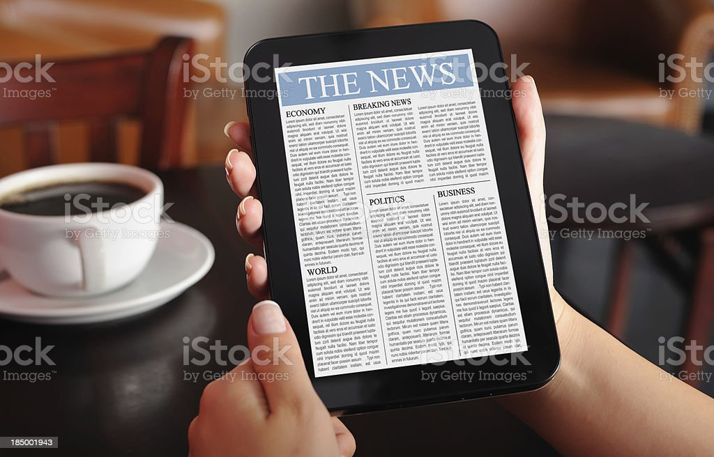 Reading news with digital tablet royalty-free stock photo
