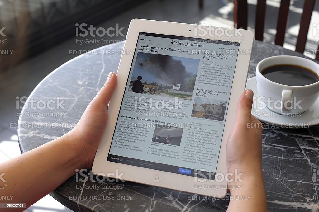 Reading news with iPad 3 royalty-free stock photo