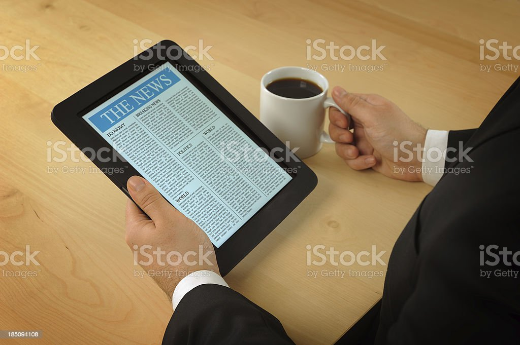Reading news with tablet pc royalty-free stock photo