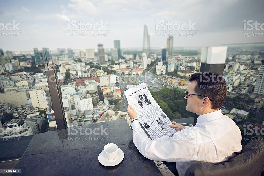 Reading newspaper stock photo