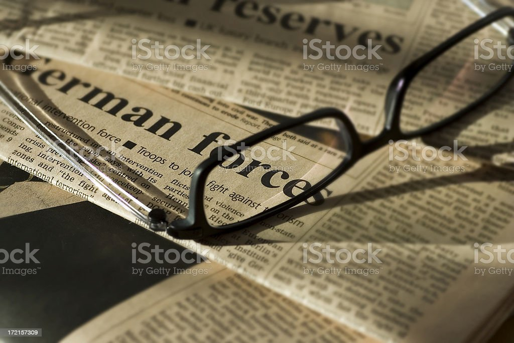 Reading newspapers royalty-free stock photo