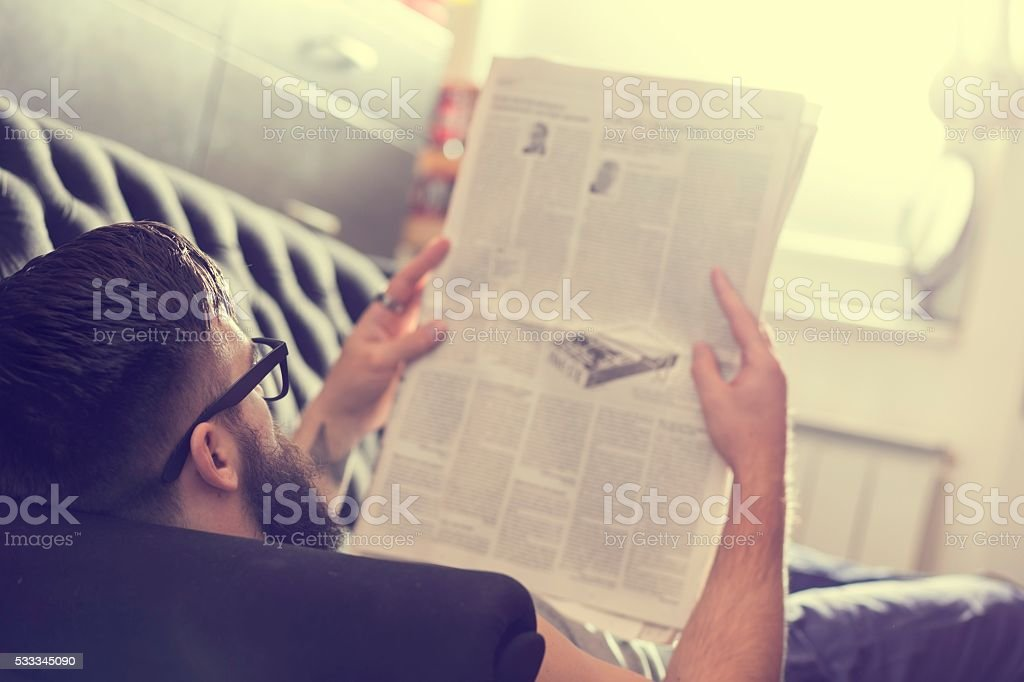Reading newspapers stock photo