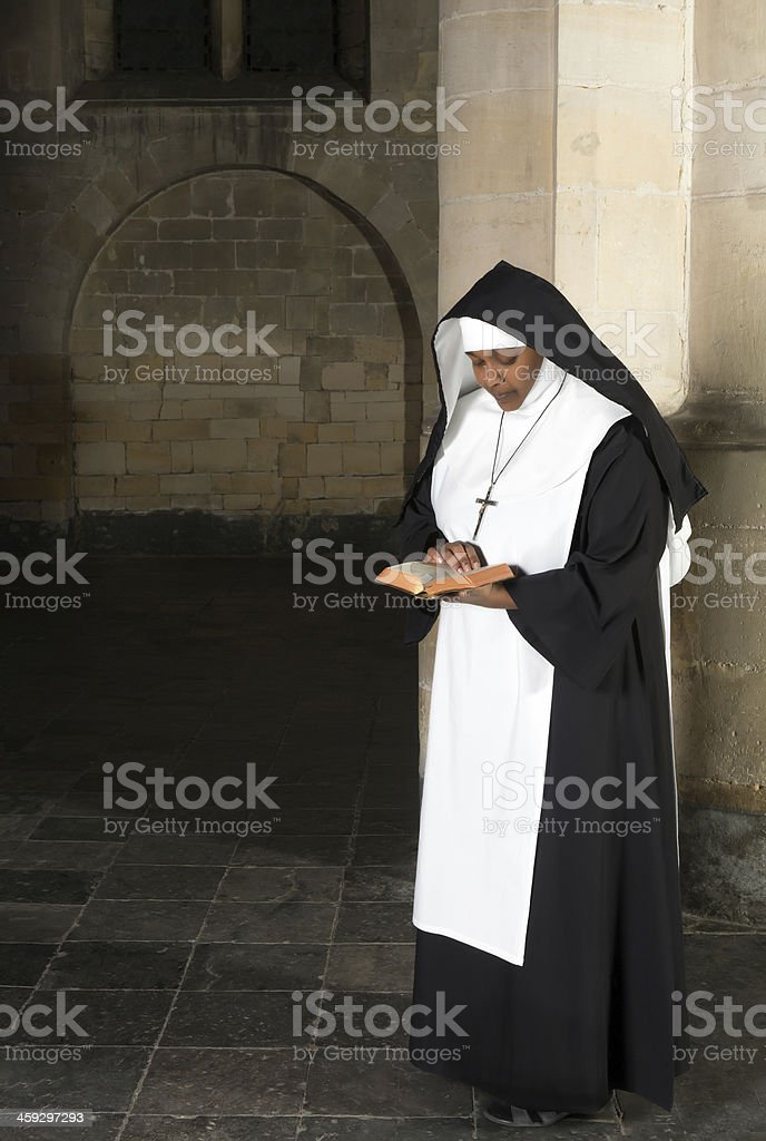 Reading nun in habit stock photo