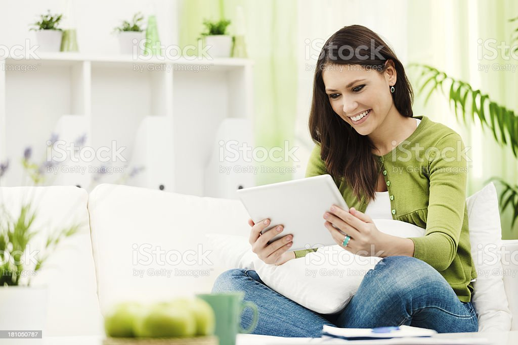 Reading on a tablet stock photo