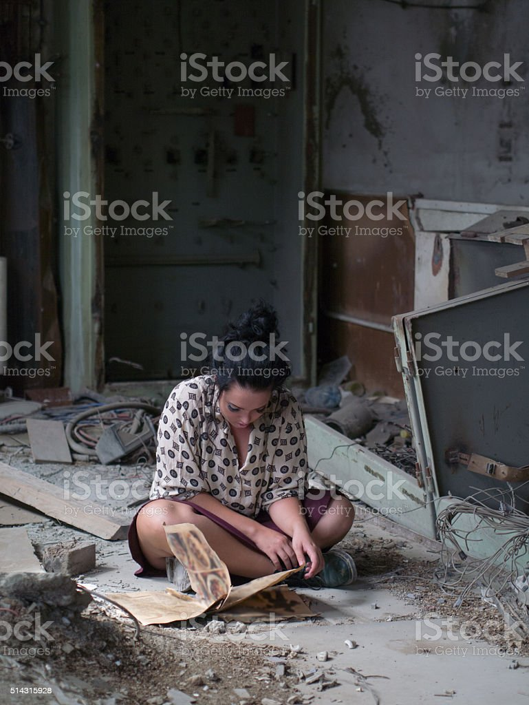 reading on the abandoned room stock photo