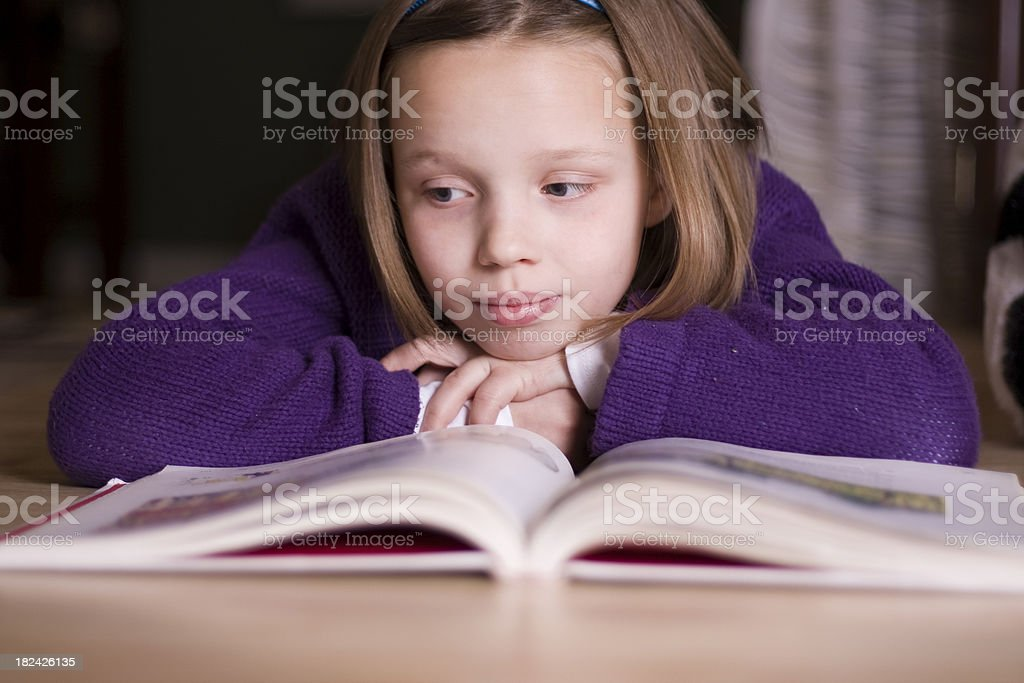 Reading on the Floor royalty-free stock photo