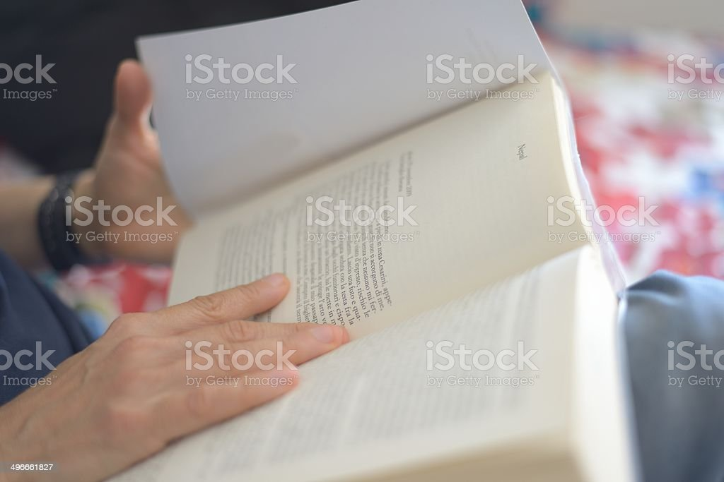 Reading paper book stock photo