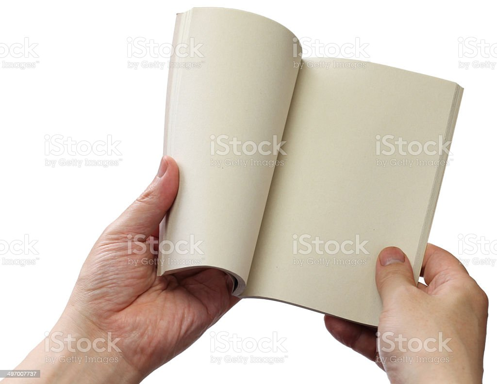 reading paperback, blank pages opens stock photo