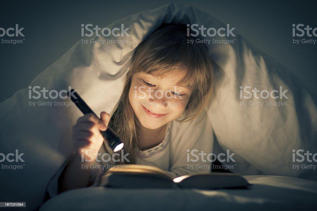 Reading past bedtime stock photo