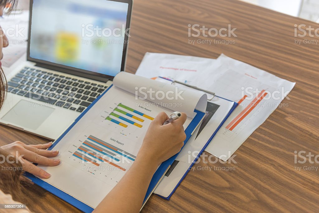 Reading reports is daily work manager must do in morning stock photo