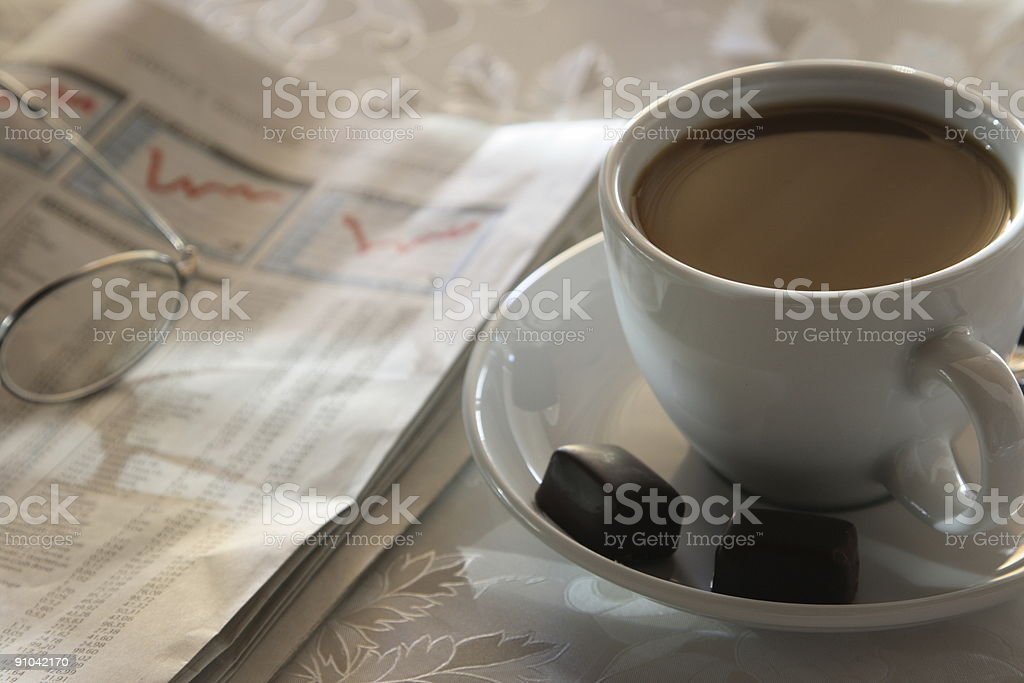 Reading Stock Exchange with Coffee royalty-free stock photo