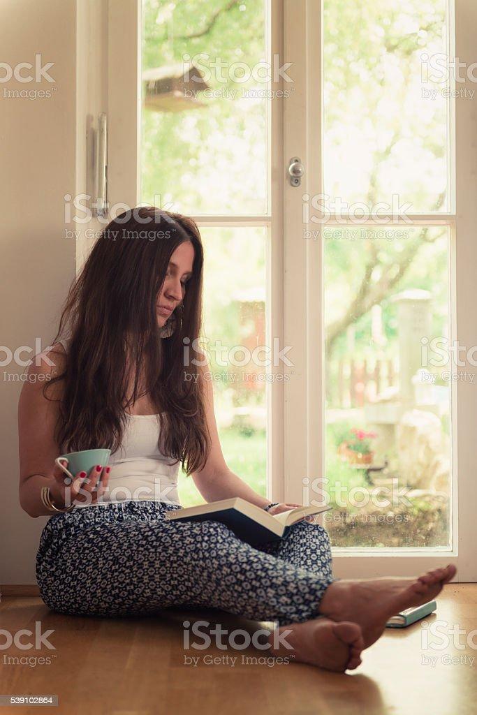 reading tea drinking women stock photo