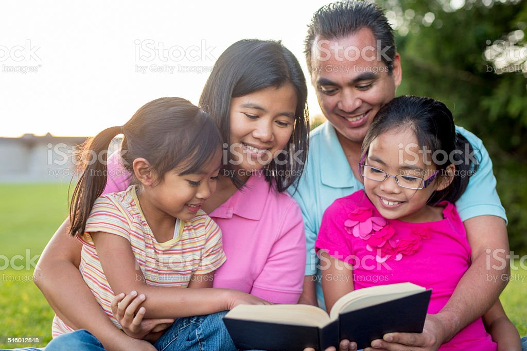 Reading the Bible as a Family stock photo
