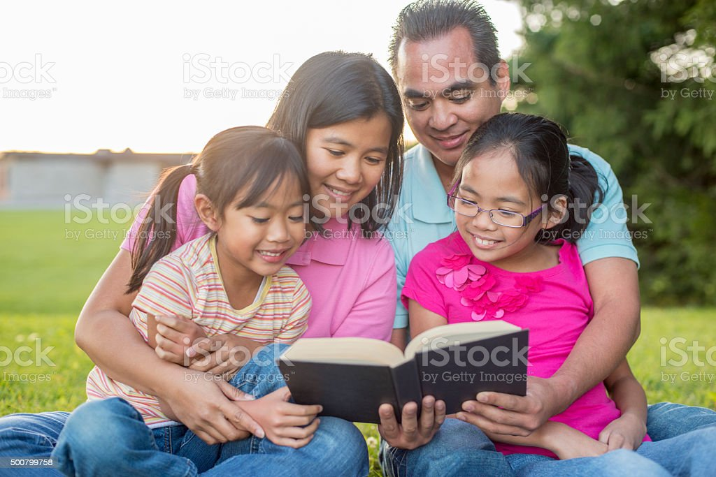 Reading the Bible Together as a Family stock photo