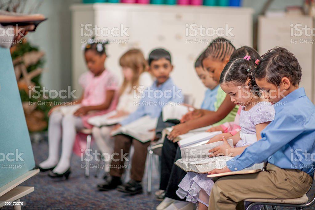 Reading the Bible Together in Class stock photo