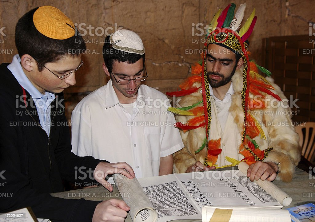 Reading the Book of Esther. stock photo