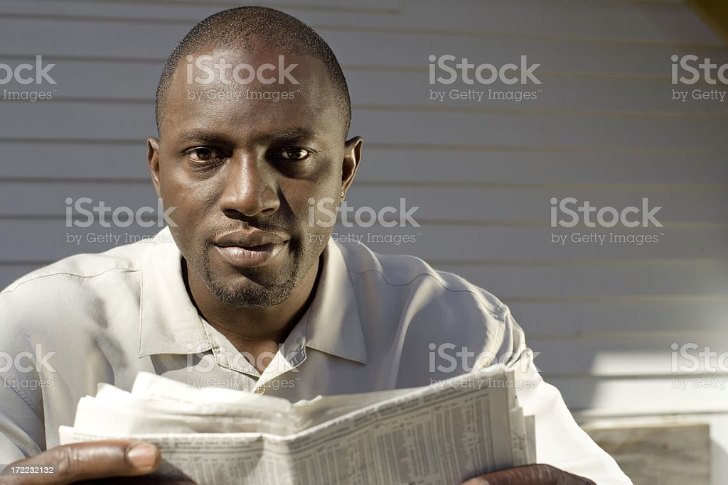 Reading the Financial Pages 2 stock photo