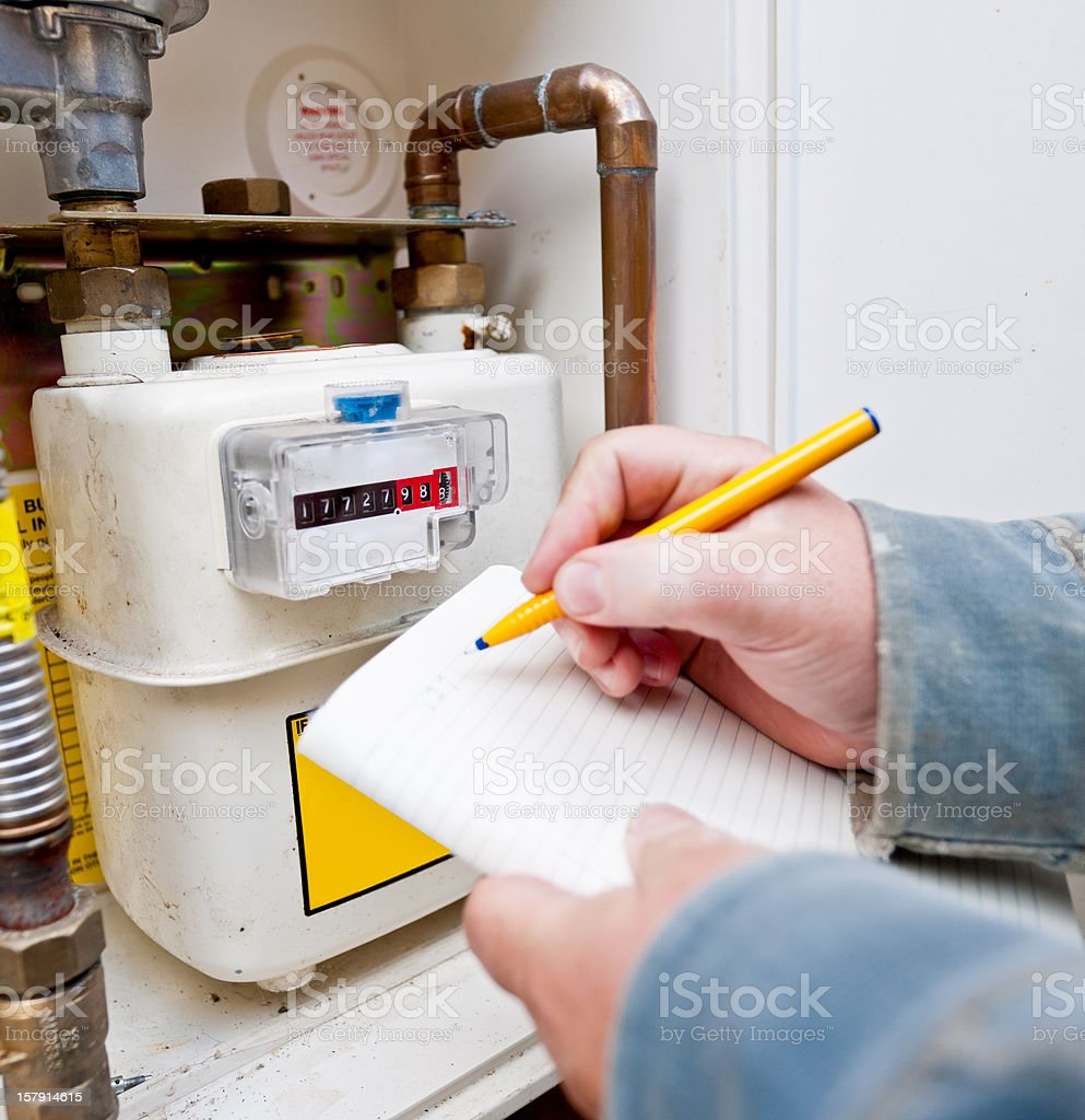 Reading the  Gas Meter stock photo