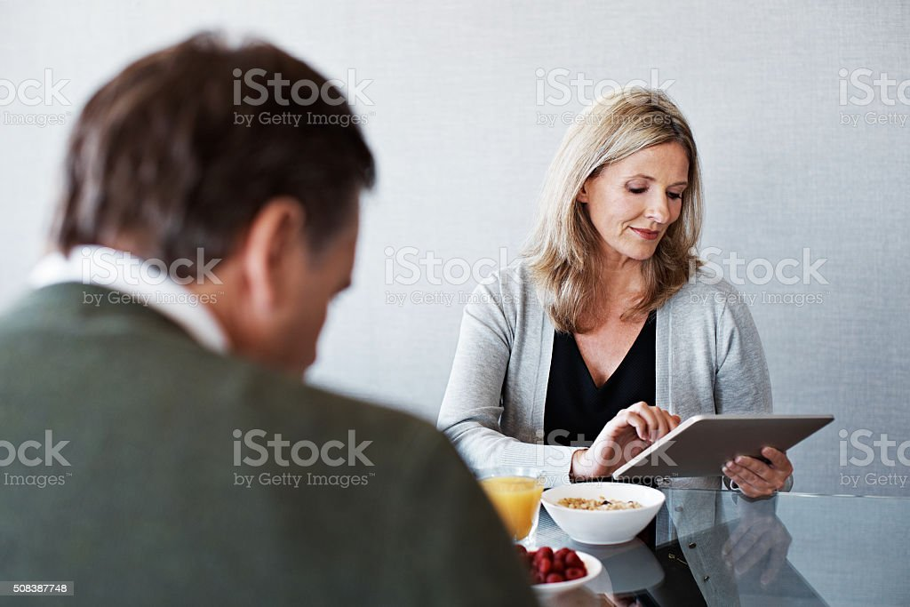 Reading the headlines over breakfast stock photo
