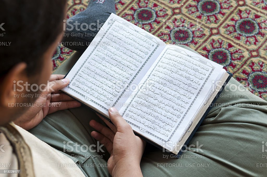 Reading the Koran at mosque stock photo