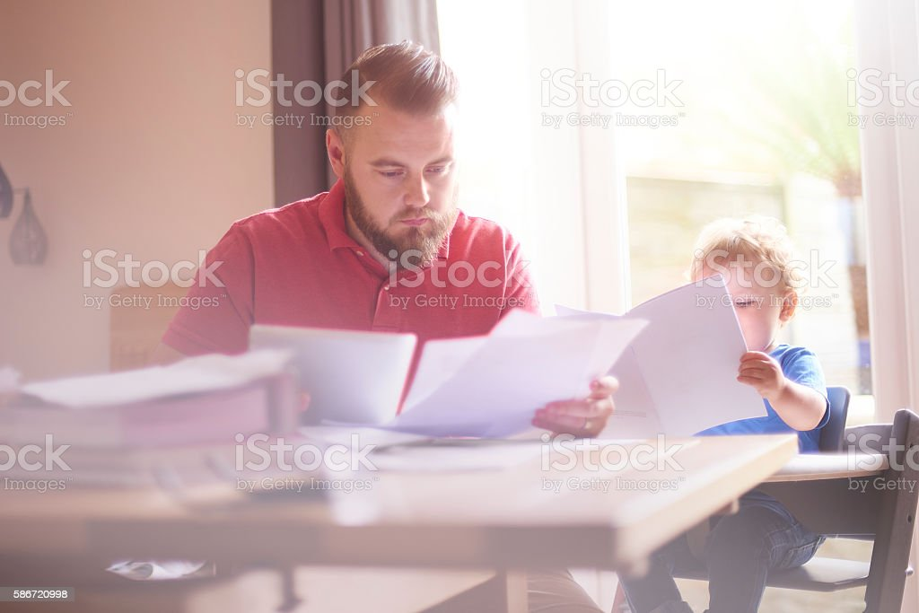 Reading the latest bills stock photo