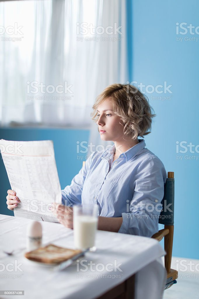 Reading The Morning Paper At Breakfast-time stock photo