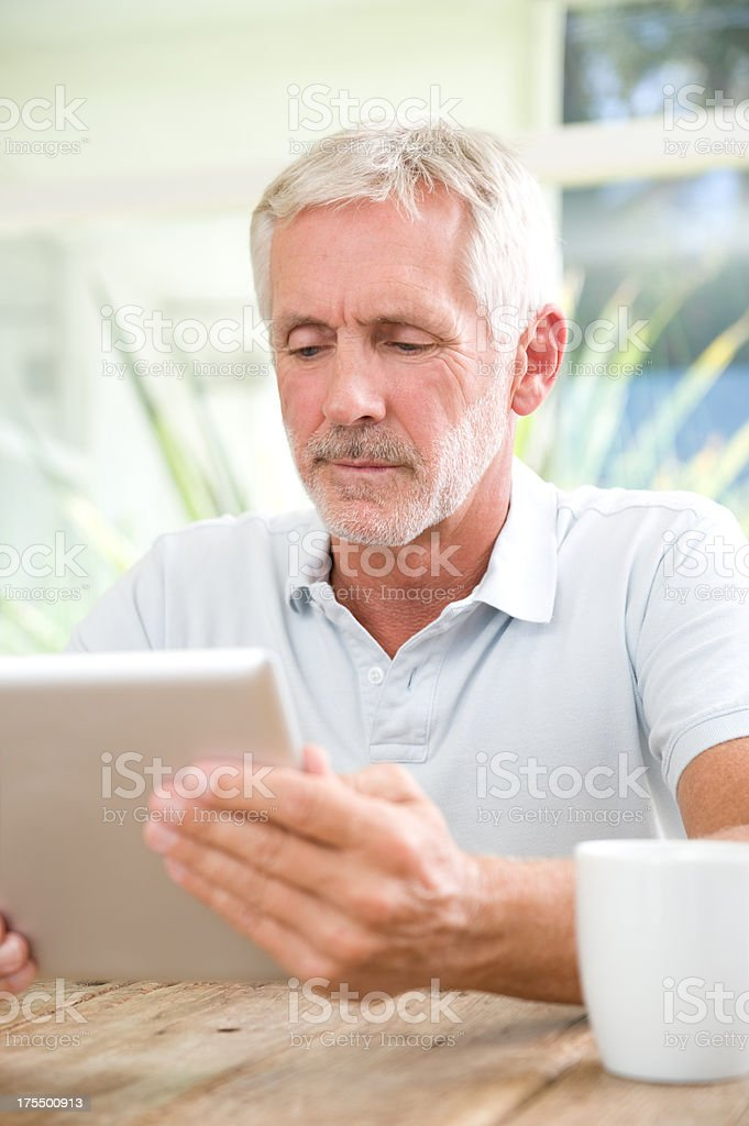 Reading the news on a digital tablet royalty-free stock photo