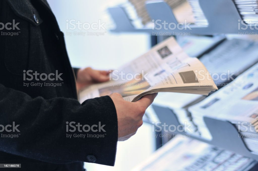 Hands with newspaper stock photo
