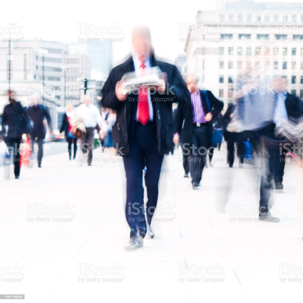 Reading the news walking royalty-free stock photo