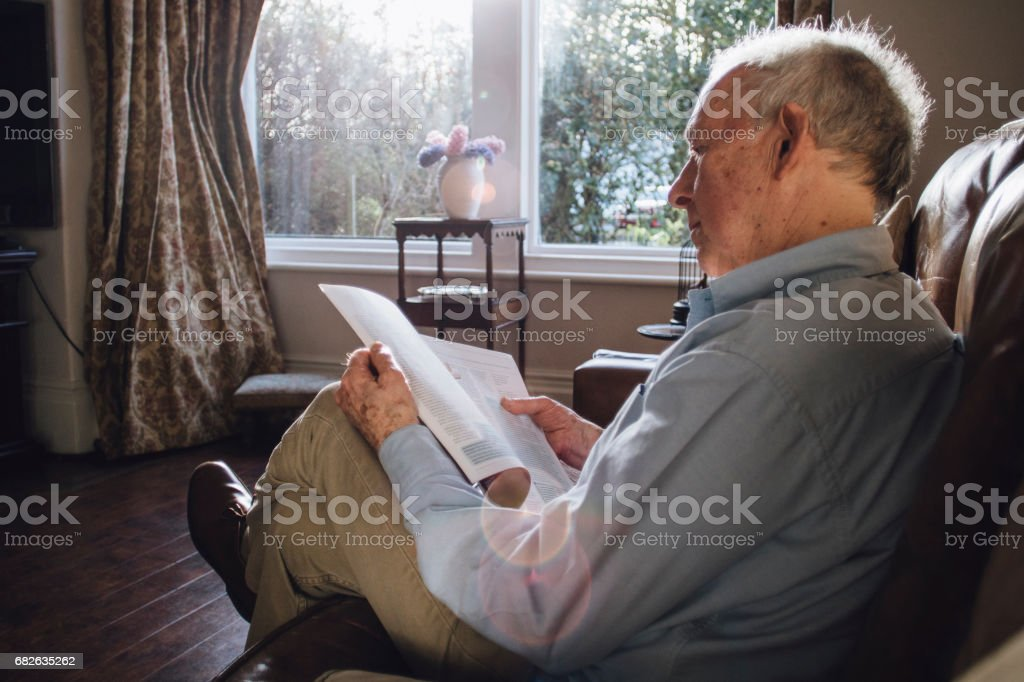 Reading The Paper stock photo
