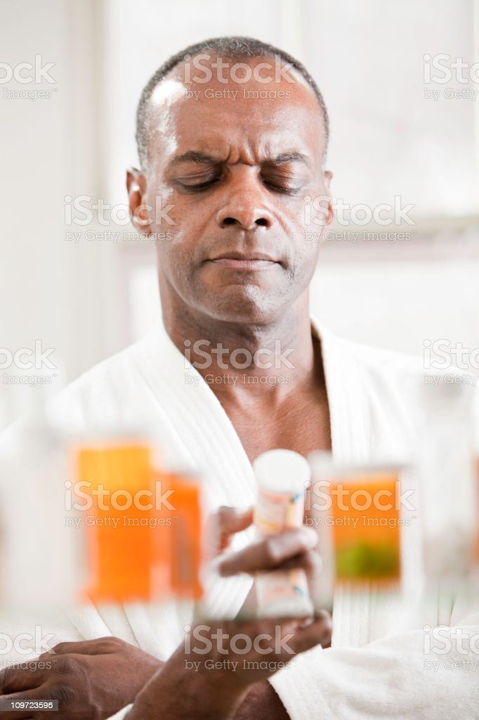 Reading The Pill Bottle stock photo