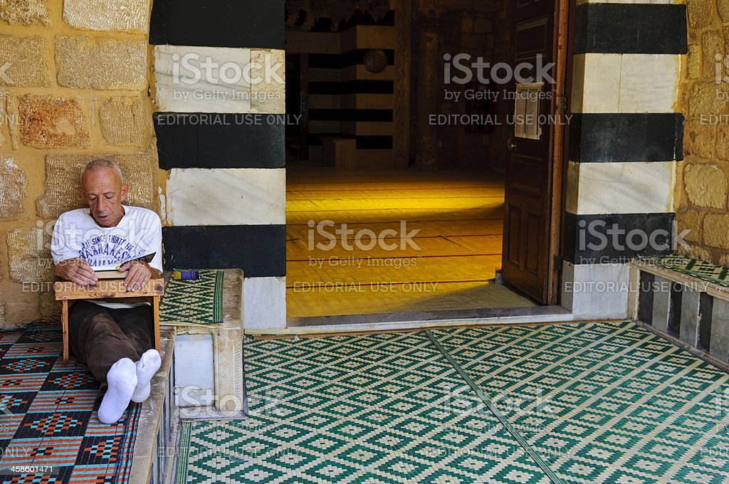 Reading the Qur'an in Tripoli, Lebanon stock photo