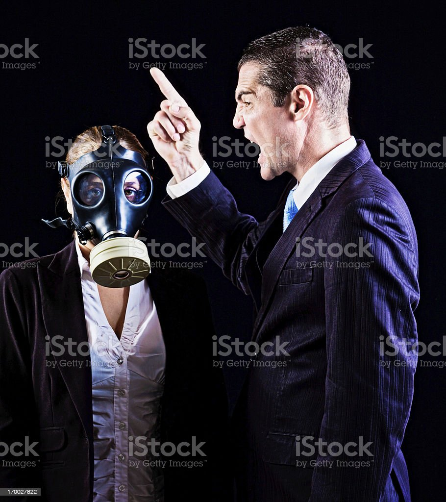 Reading the riot act! Man yells at uncaring gas-masked woman royalty-free stock photo
