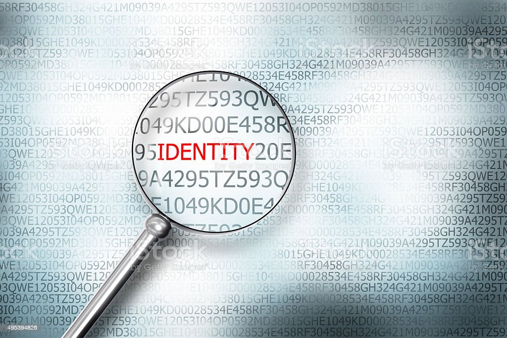 reading the word identity on computer screen magnifying g stock photo