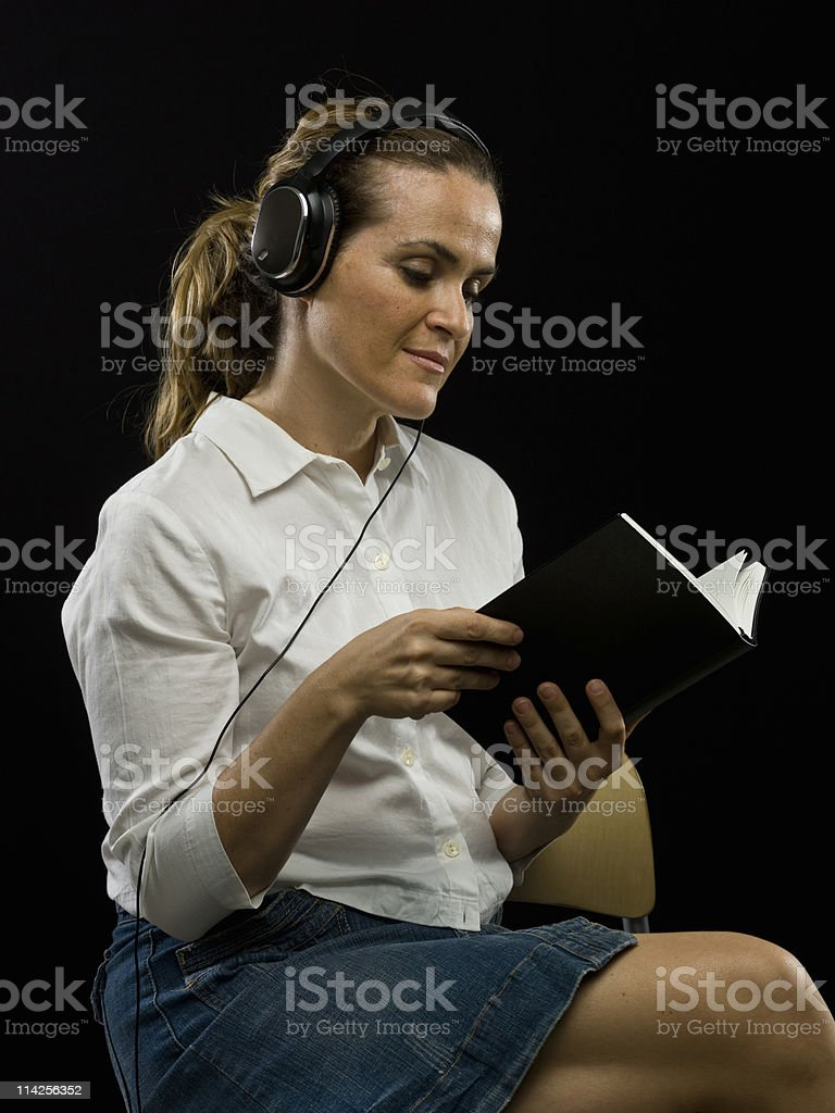 Reading while listening to the music royalty-free stock photo