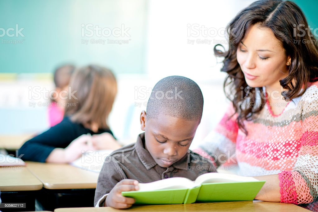 Reading with a Little Boy stock photo