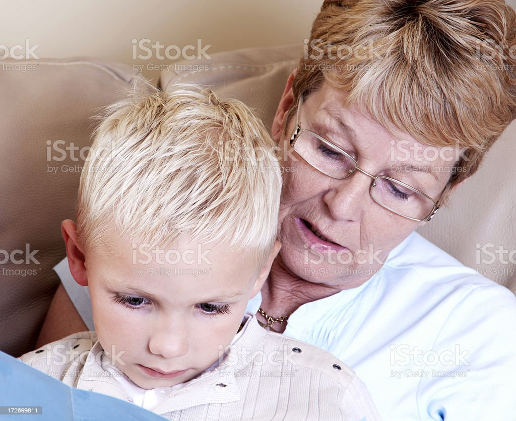 reading with gran royalty-free stock photo