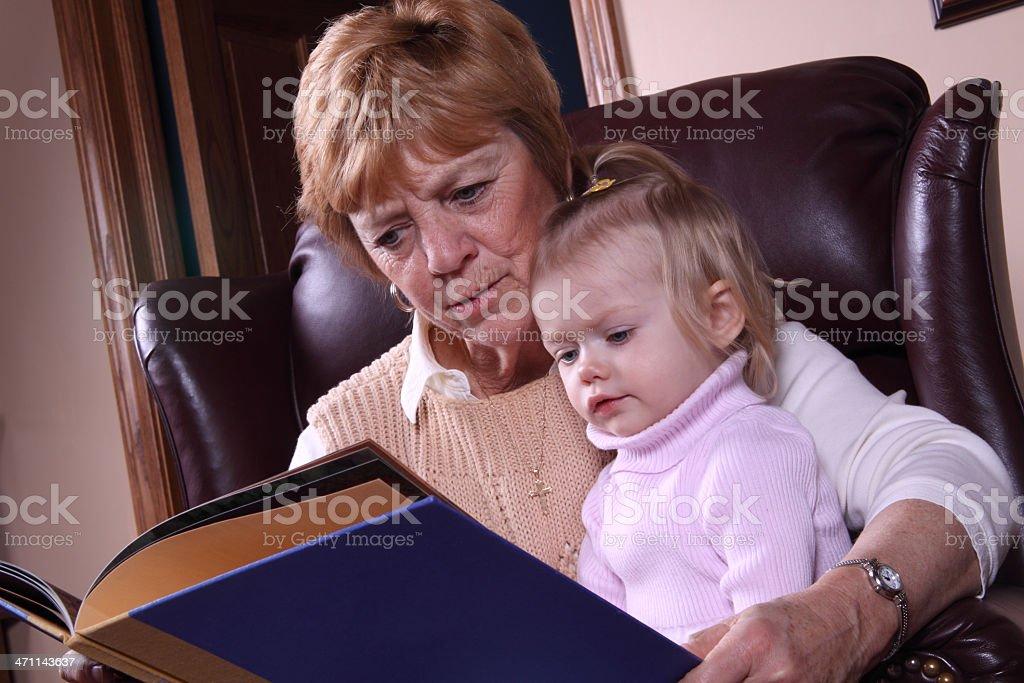 Reading with Grandma royalty-free stock photo