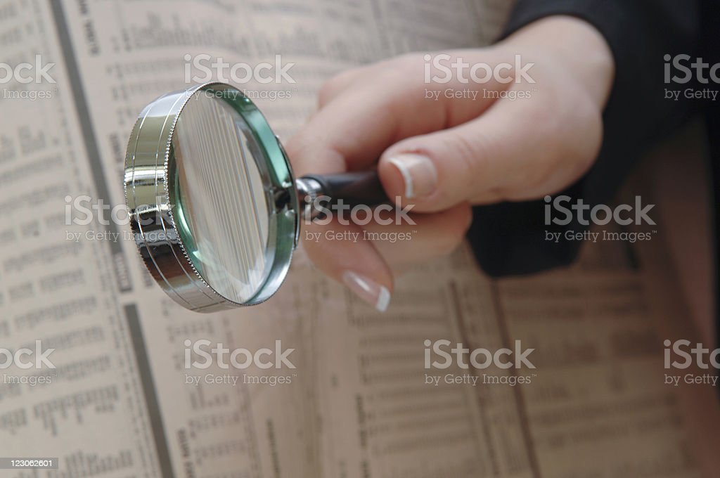 Reading with magnifying glass royalty-free stock photo