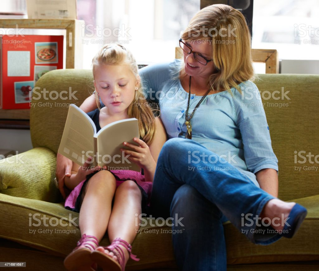 Reading with mom royalty-free stock photo