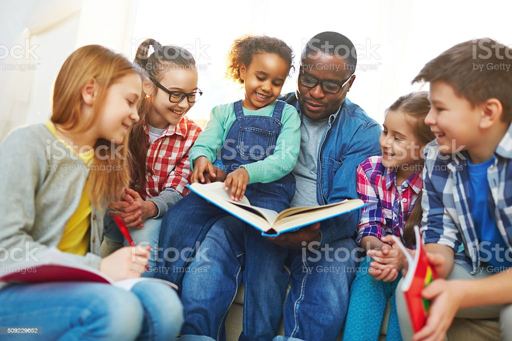 Reading with teacher stock photo