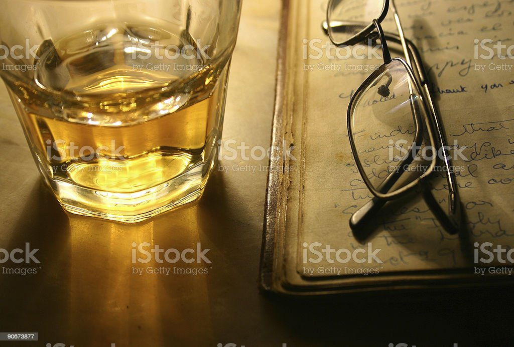 Reading with Whisky stock photo