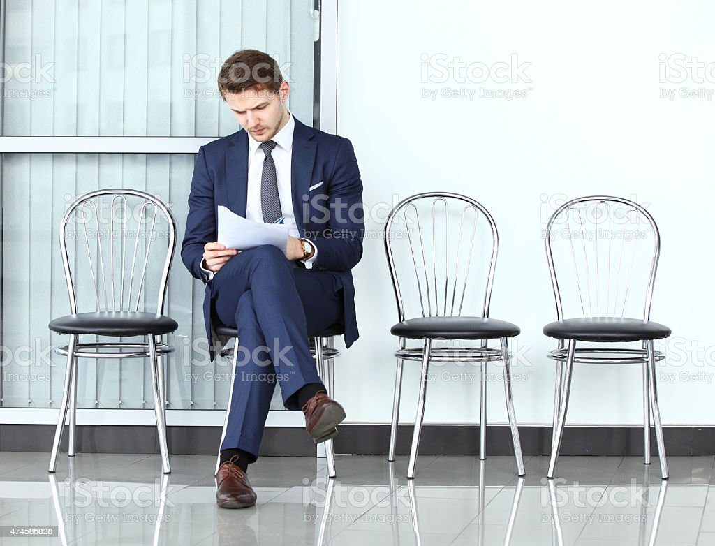 Ready for interview. Thoughtful man in formalwear holding paper stock photo