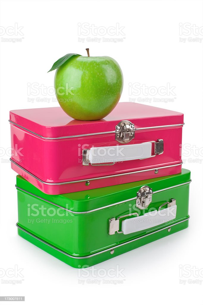 Ready for school with a shiny apple and lunchboxes stock photo