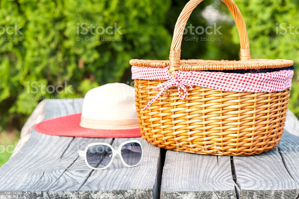 Ready for summer holidays. Sunglasses hat and wicker basket. stock photo