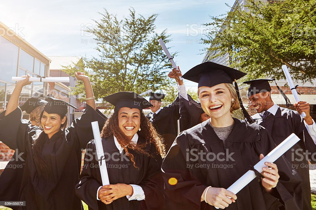 Ready for the world with diploma in hand stock photo