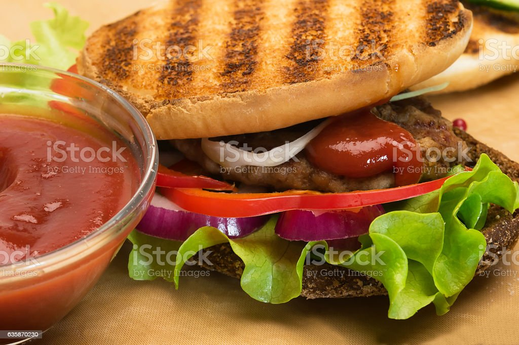 ready sandwich with fried pork, vegetables and toast stock photo