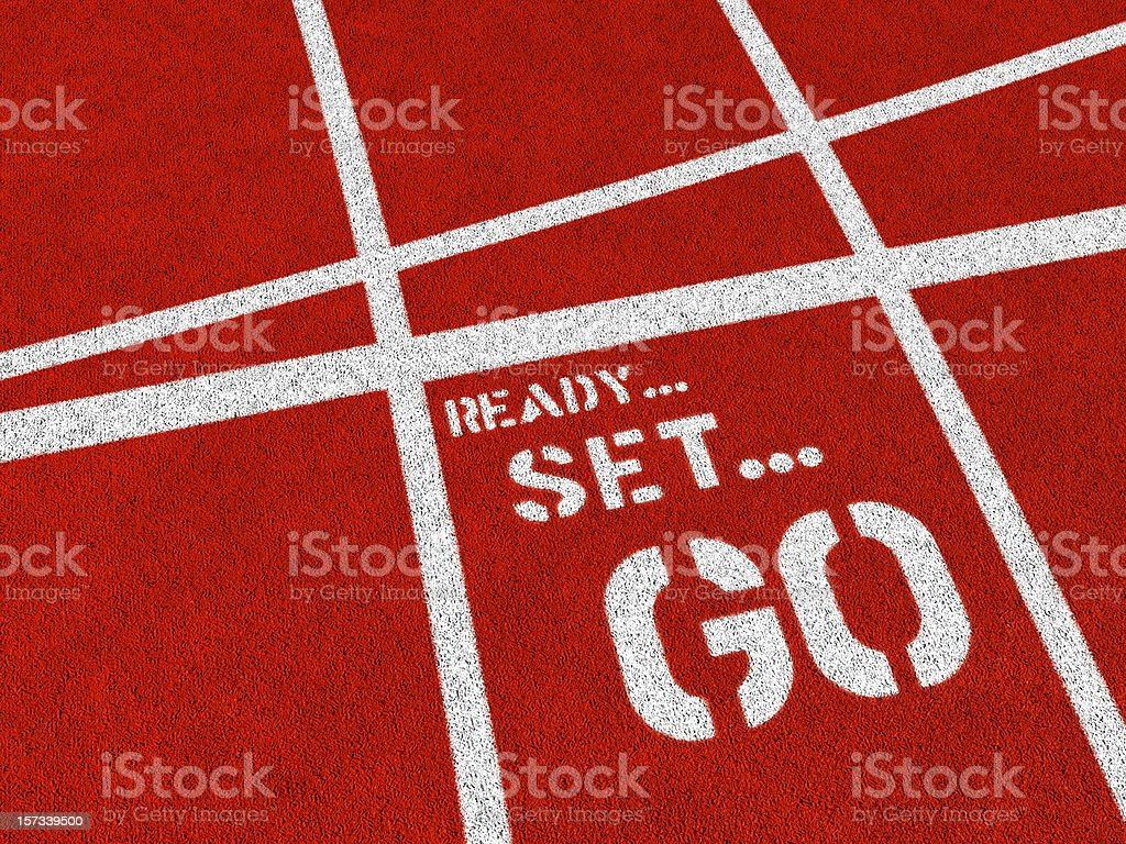 Ready set go written in white on a red track royalty-free stock photo