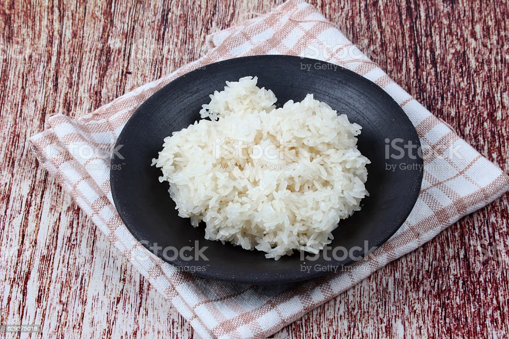 Ready sticky rice served on bamboo background. stock photo