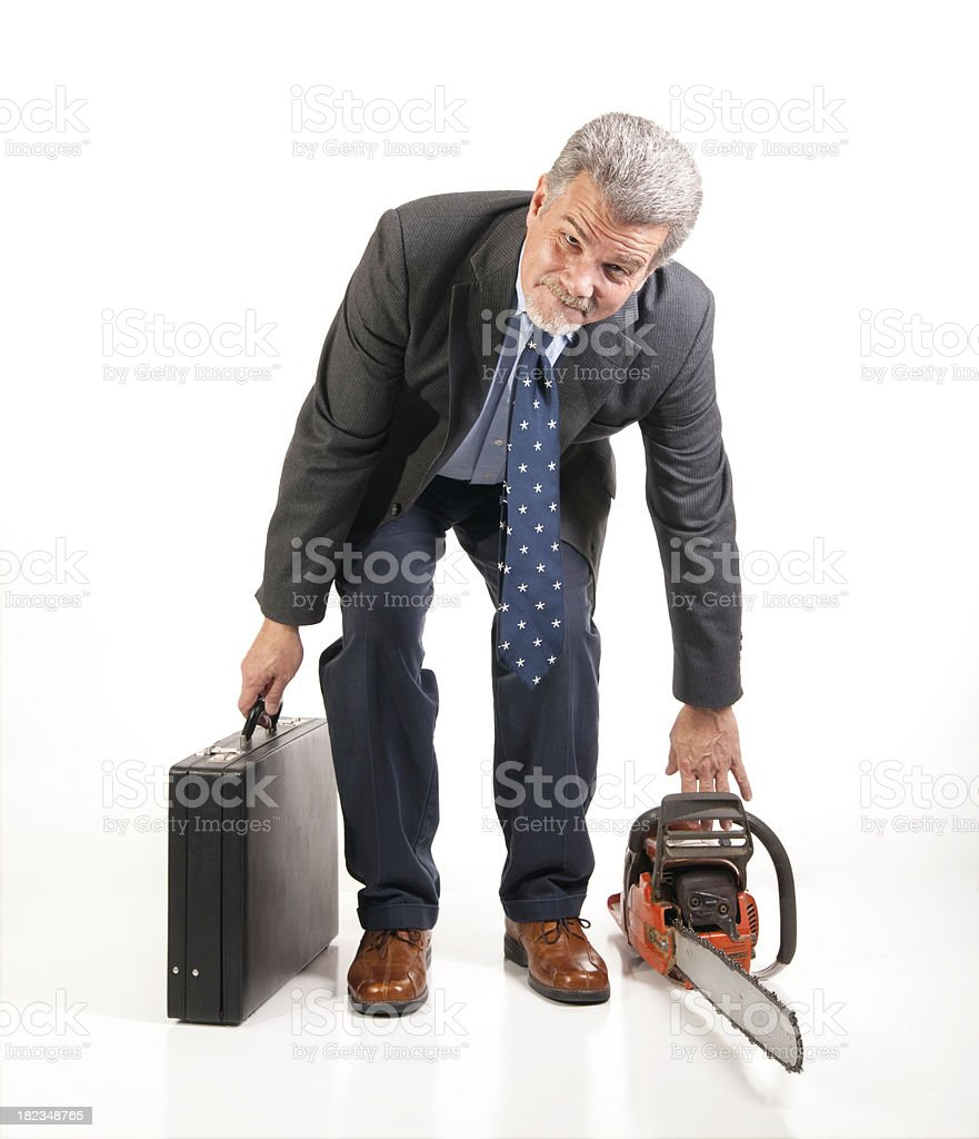 Caucasian business man with a briefcase and a chainsaw